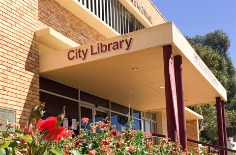 The Broken Hill City Library with roses in the foreground