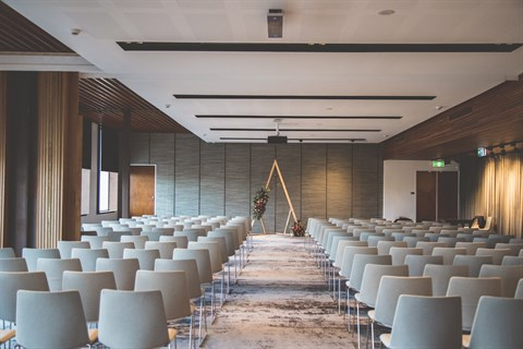 Combined upstairs function room set theatre style with a centre aisle