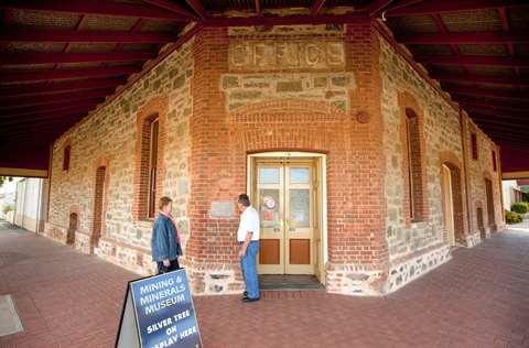 Two people stand outside the Albert Kersten Mining and Minerals Museum