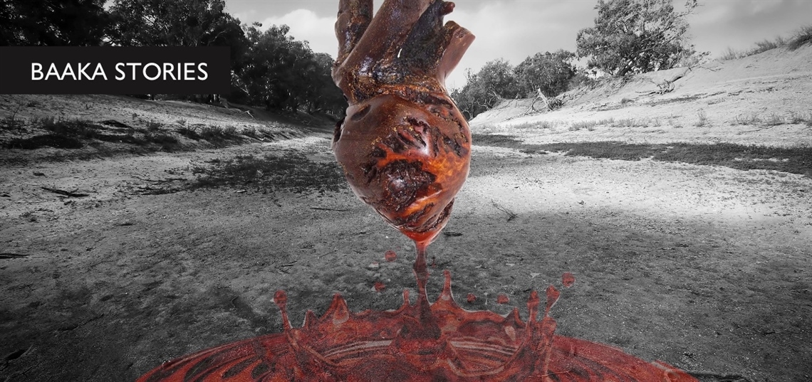 A wooden heart bleeds against the dry black and white backdrop to the Darling River