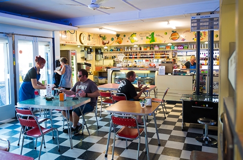 The interior of Bell's Milk Bar, with a customer being served by a waitress