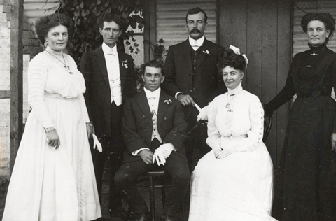 Black and white historical photograph of a wedding party