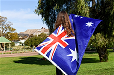 A Teenager with the Australian Flag draped across her back