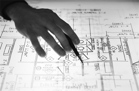 Someone pointing to a building diagram
