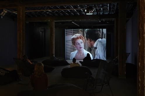 image of people watching film in gallery