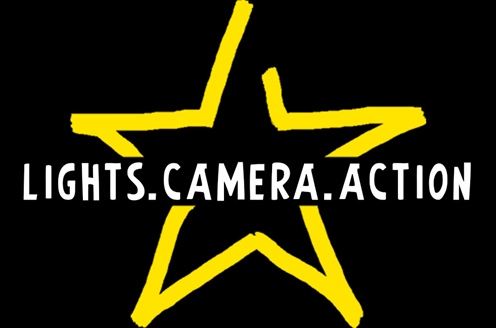 Black background with yellow five point star and the words lights camera action through the centre