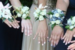 A group of girls displaying their corsages