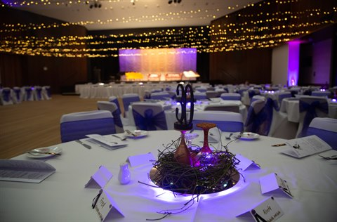 Civic Centre Auditorium with purple lighting and dinner setting